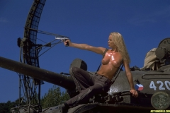 ActionGirls Sylvia Fires Big Guns 01