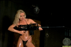 ActionGirls Sylvia Fires Big Guns 03