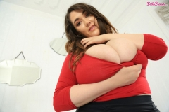 Bella-Brewer-Naked-Huge-Tits-Cleavage-Red-Top-and-Miniskirt-015