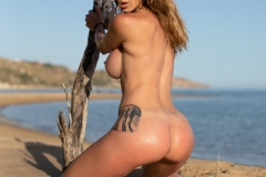 Cyrelle-Big-Tits-Look-Hot-on-the-Beach-for-Photodromm-011