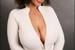 Denise Milani Huge Boobs in a White Cardigan 018