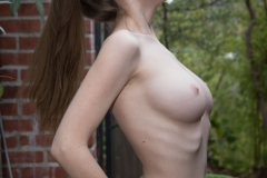 Emily Bloom Big Tits Get Naked in the Garden Chair 006