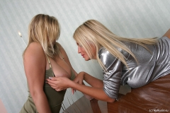 Ines-Cudna-Big-Tit-Bllonde-plays-with-Malina-on-the-Table-002