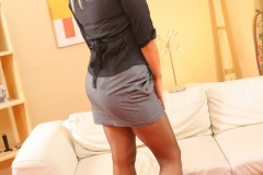 Kate C busting out of her tight, black blouse and flashing some leg in her smart, grey miniskirt. 06