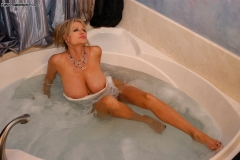 Kelly Madison Huge Boobs Get Wet and Naked in the Bath 006