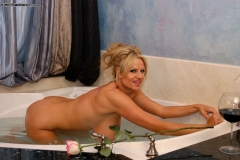 Kelly Madison Huge Boobs Get Wet and Naked in the Bath 011
