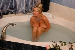 Kelly Madison Huge Boobs Get Wet and Naked in the Bath 014