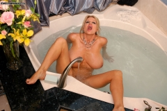 Kelly Madison Huge Boobs Get Wet and Naked in the Bath 015