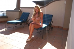Kelly Madison Huge Tits Come Out of Minidress 013