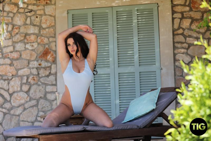 Kym-Graham-Big-Boob-Girl-in-White-Swimsuit-003