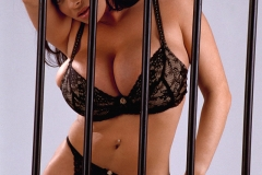 Linsey Dawn McKenzie Huge Tits in a Black Bra Behind Bars 002