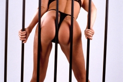 Linsey Dawn McKenzie Huge Tits in a Black Bra Behind Bars 004
