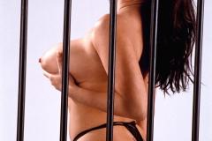 Linsey Dawn McKenzie Huge Tits in a Black Bra Behind Bars 007
