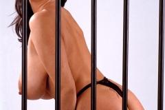 Linsey Dawn McKenzie Huge Tits in a Black Bra Behind Bars 009