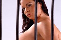 Linsey Dawn McKenzie Huge Tits in a Black Bra Behind Bars 010
