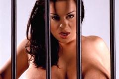 Linsey Dawn McKenzie Huge Tits in a Black Bra Behind Bars 012