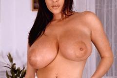Linsey-Dawn-McKenzie-Huge-Tits-on-a-Blue-Sofa-003