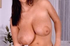 Linsey-Dawn-McKenzie-Huge-Tits-on-a-Blue-Sofa-004