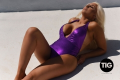 Lucy-James-Big-Tit-Blonde-in-Sparkly-Purple-Swimsuit-004