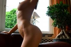 Orsi Kocsis Big Boobs Naked on a Sofa by the Window 011