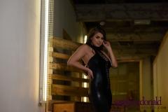 Sarah McDonald Big Breasts in Tight Shiny Stretchey Black Catsuit 007
