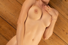 Stella-Big-Tits-Lying-on-a-Hard-wooden-Floor-for-Body-in-Mind-009