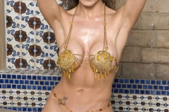 Taya-Parker-Big-Tits-in-Gold-Bikini-for-Penthouse-001