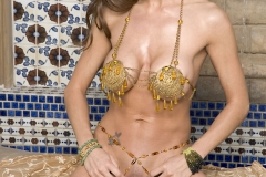 Taya-Parker-Big-Tits-in-Gold-Bikini-for-Penthouse-002
