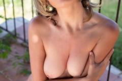Teodora-Naked-Tits-in-White-Minidress-for-Photodromm-027