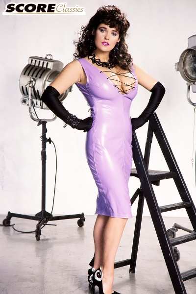 Tracey-Neve-Big-Tits-Strapped-into-Purple-Latex-Dress-001