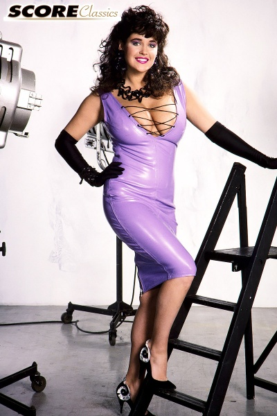 Tracey-Neve-Big-Tits-Strapped-into-Purple-Latex-Dress-003