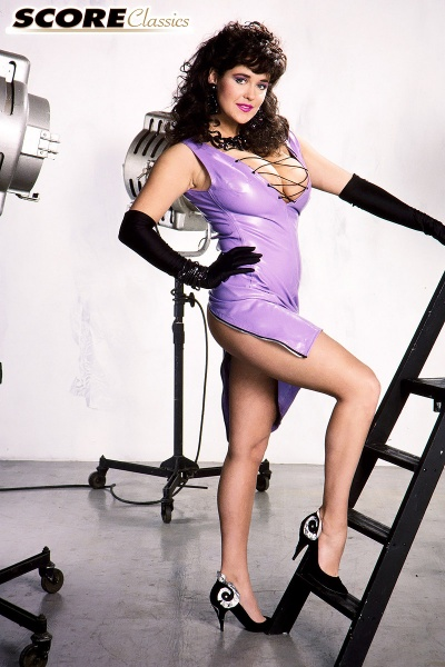 Tracey-Neve-Big-Tits-Strapped-into-Purple-Latex-Dress-005