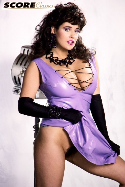 Tracey-Neve-Big-Tits-Strapped-into-Purple-Latex-Dress-007