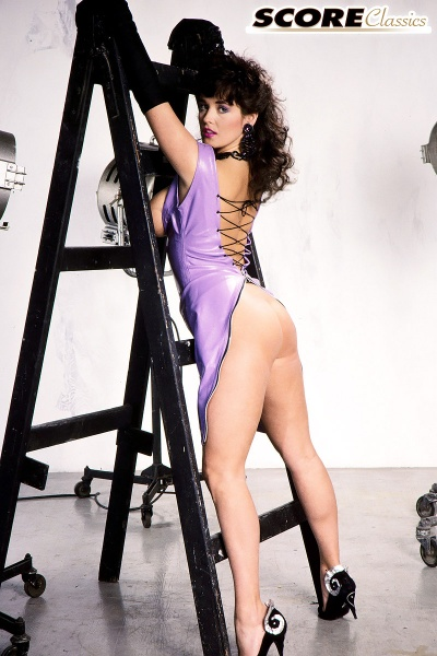 Tracey-Neve-Big-Tits-Strapped-into-Purple-Latex-Dress-010
