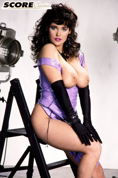 Tracey-Neve-Big-Tits-Strapped-into-Purple-Latex-Dress-011
