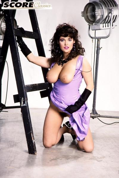 Tracey-Neve-Big-Tits-Strapped-into-Purple-Latex-Dress-012