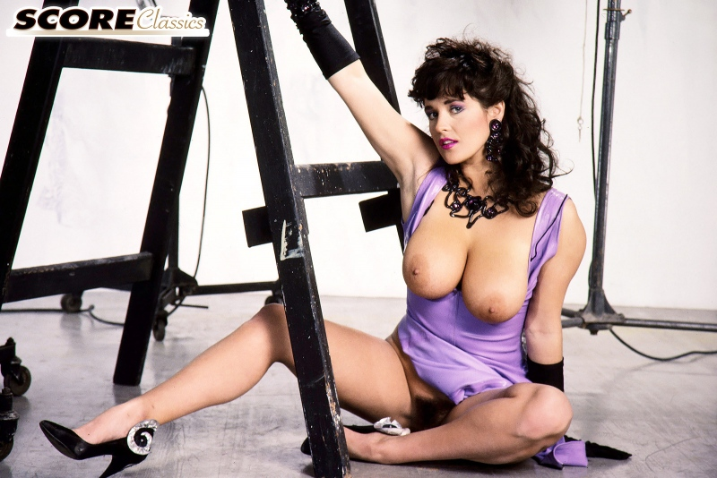 Tracey-Neve-Big-Tits-Strapped-into-Purple-Latex-Dress-013