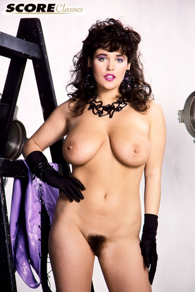 Tracey-Neve-Big-Tits-Strapped-into-Purple-Latex-Dress-016