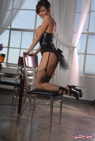 Veronica-Avluv-Big-Tits-in-Shiny-Black-Corset-and-Fishnet-Stockings-045
