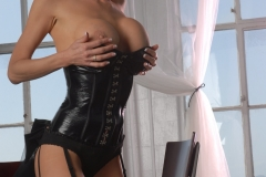 Veronica-Avluv-Big-Tits-in-Shiny-Black-Corset-and-Fishnet-Stockings-035