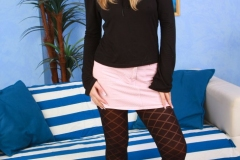 Veronika-big-tits-in-a-wonderful-short-pink-skirt-with-patterned-opaque-tights-001