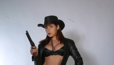 Erica Campbell Long Black Leather Coat and Gun