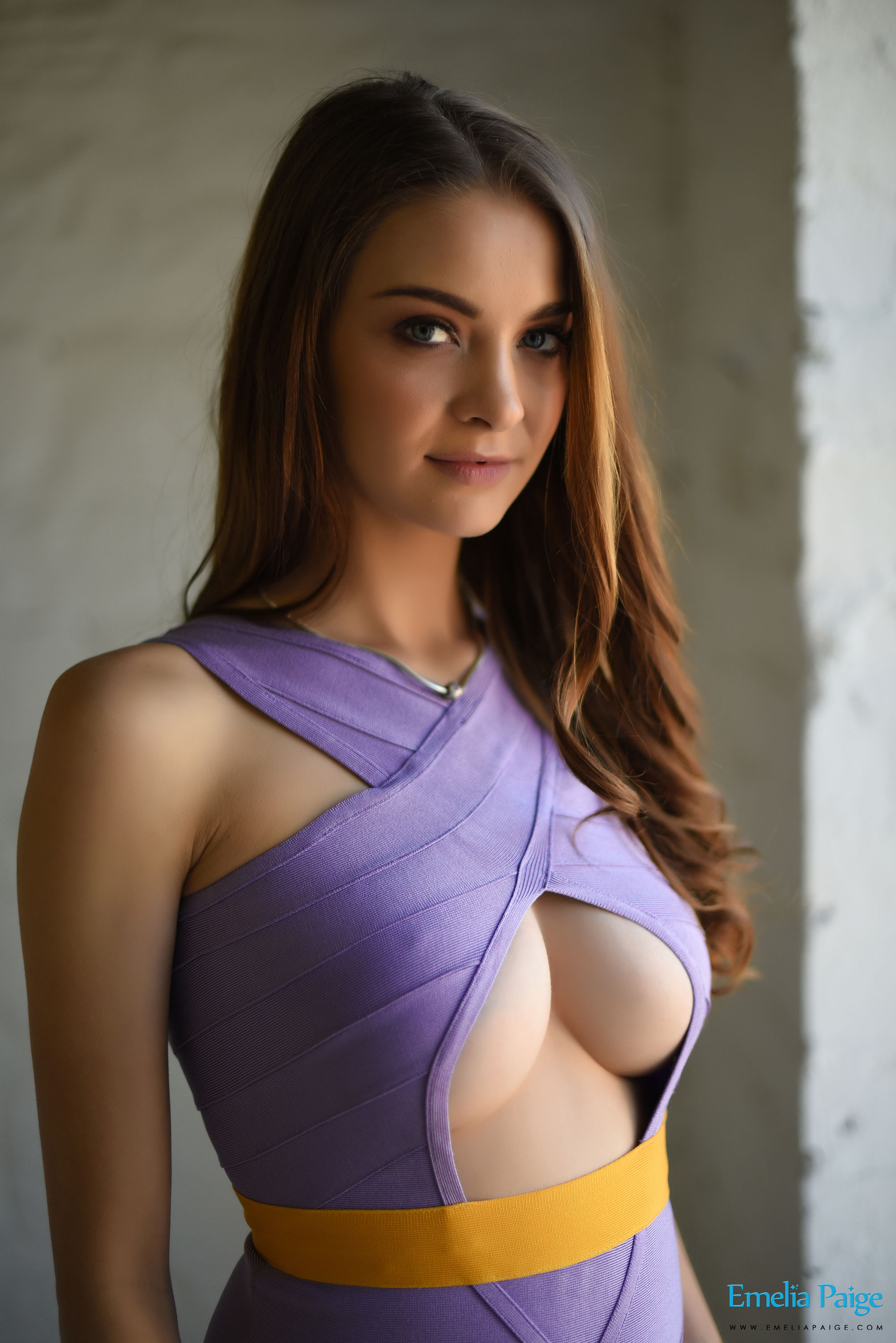 Emelia Page boobs bursting from purple dress