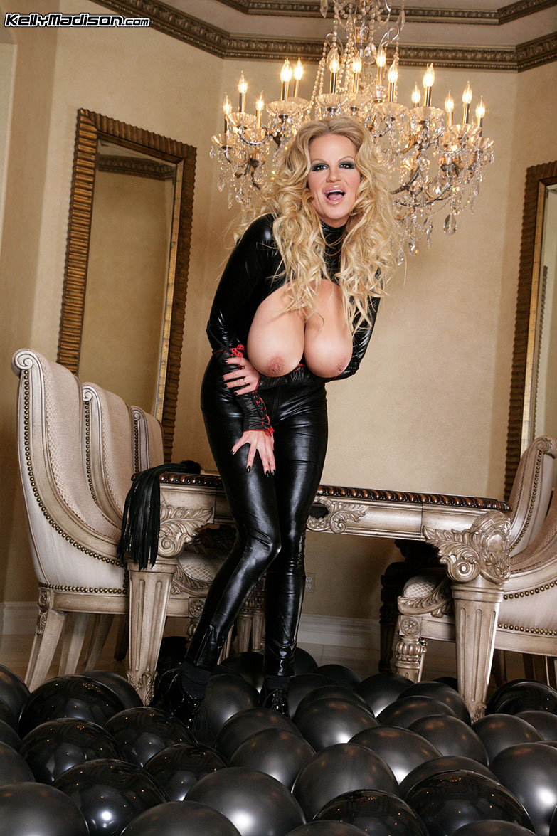 Kelly Madison Huge Tits in Latex Catsuit