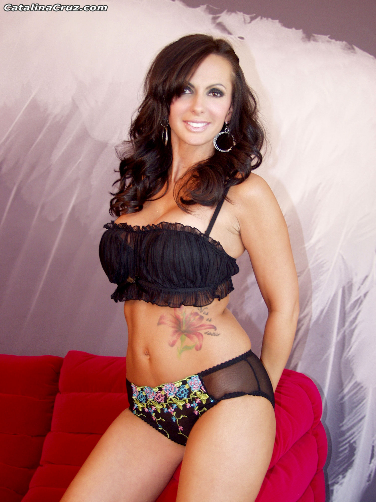 Catalina Cruz Huge Breasts Sitting on a Sofa