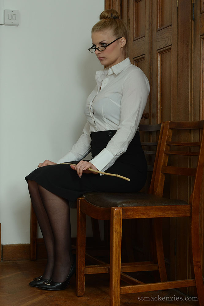 Deputy Headmistress Drogan Very Stern with a Cane