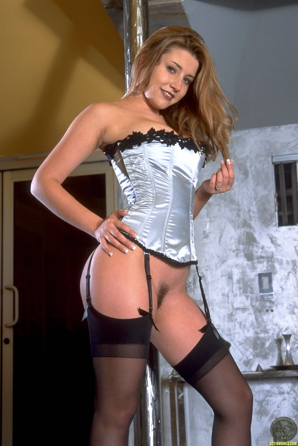 Erica Campbell Big Tits in Silver Corset for ActionGirls