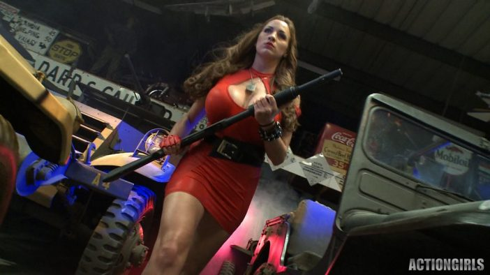 Jordan Carver Huge Tits Red Leather Gun Toting Babe for Actiongirls