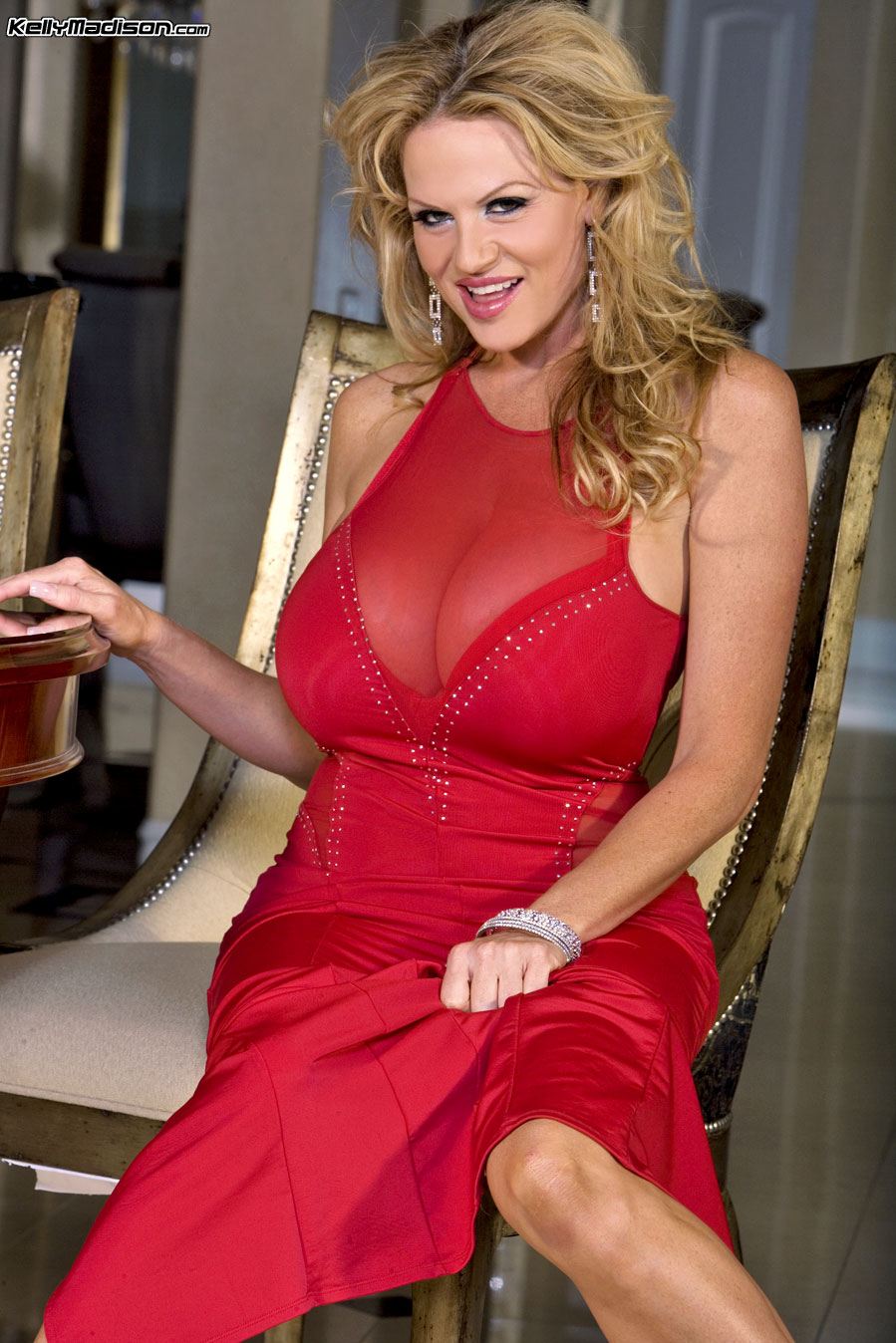 Kelly Madison Huge Tits in Red Minidress